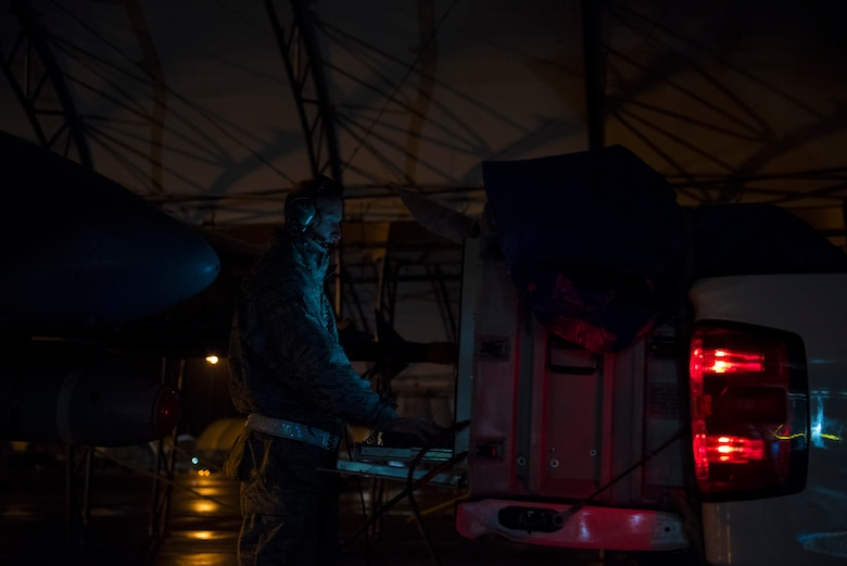 """Staff Sgt. Jarrod Eckerd, a Combat Shield crew leader assigned to the 16th Electronic Warfare Squadron, Eglin Air Force Base, Fla., simulates radar emissions with a USM-642 """"Raven"""" signal generator during Combat Shield, Dec. 5, 2016, at Moody Air Force Base, Ga. From Nov. 30 – Dec. 6, 16th EWS Airmen evaluated the EW operations and maintenance actions for Moody's aircraft fleet to ensure they can maintain dominance of the electromagnetic spectrum. (U.S. Air Force photo by Airman 1st Class Greg Nash)"""