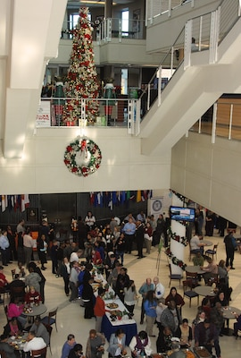 The annual McNamara Headquarters Complex tree lighting ceremony and holiday social brings together employees from the Defense Logistics Agency, Defense Threat Reduction Agency, Defense Contract Audit Agency and Defense Technical Information Center.