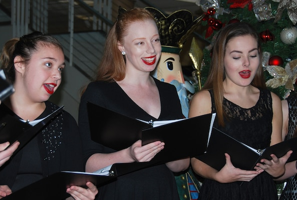 "Hannah Weilminster, Cayli Dobbs and Shannon O'Shaughnessy from the Metropolitan School of the Arts Academy sing ""Gloria in Excelsis Deo"" during the annual McNamara Headquarters Complex tree lighting ceremony Dec. 7."