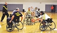 Jill Sump, right, an occupational therapist for the Warrior Transition Battalion, reaches for the basketball in a turnover during the game at the Fort Riley Whitside Fitness Center Nov. 7.