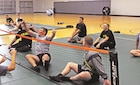 Players work to volley the ball back during the Warrior Transition Battalion volleyball competition Nov. 8 at the Fort Riley Whitside Fitness Center Nov. 7.