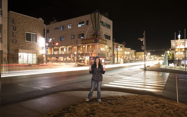 U.S. Air Force Airman 1st Class Sadie Colbert, a 35th Fighter Wing public affairs photojournalist, poses for a photo in Misawa City, Japan, Dec. 1, 2016. Getting out and exploring provides opportunities to meet Japanese locals and discover the various festivals, activities and food joints, making life an adventure during the holiday season. (U.S. Air Force photo by Senior Airman Brittany Chase)