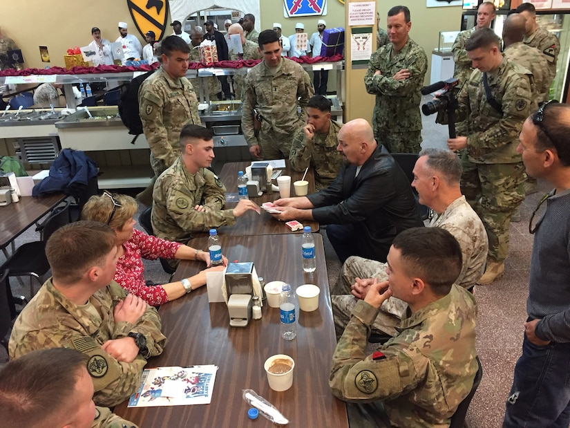 Marine Corps Gen. Joe Dunford, chairman of the Joint Chiefs of Staff, watches as mentalist Jim Karol entertains service members at Bagram Airfield, Afghanistan, Dec. 7, 2016. Dunford is leading a USO tour featuring entertainers and athletes to bring a bit of home to deployed troops. DoD photo by Jim Garamone