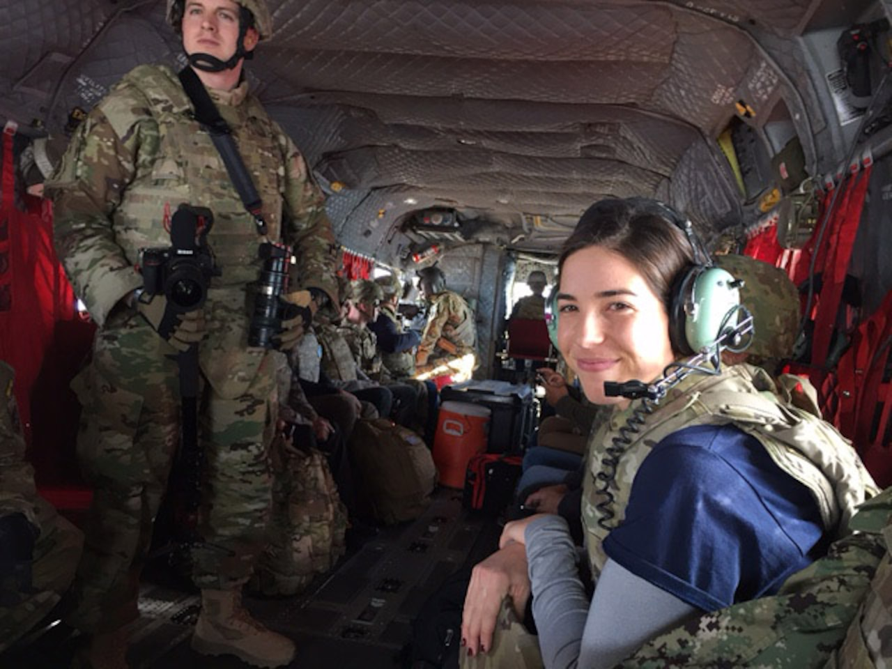 Olympic gold medalist Maya DiRado rides in a CH-47 helicopter to Forward Operating Base Gamberi, Afghanistan, as part of the 2016 Holiday USO Tour, Dec. 7, 2016. DoD photo by Jim Garamone