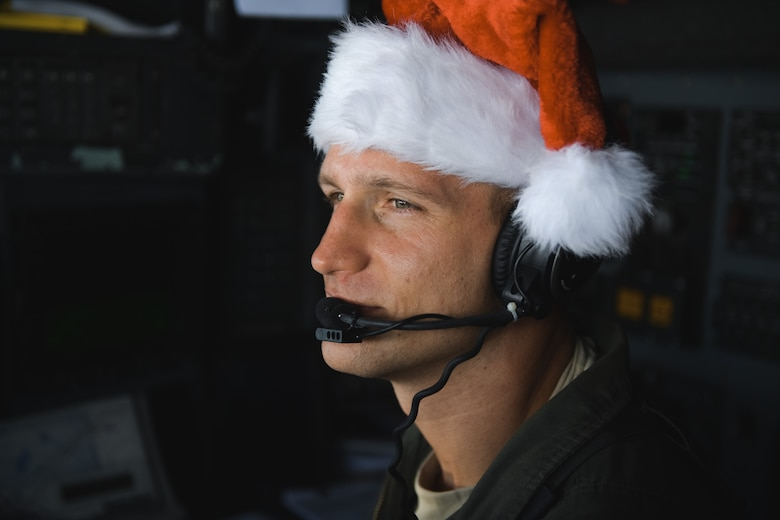 Capt. Darryl Lawlor, 36th Airlift Squadron C-130 Hercules navigator, observes the skies during Operation Christmas Drop 2016 over remote Micronesian islands, Dec. 6, 2016. This year marks 65 years of Operation Christmas Drop which provides joint airlift training opportunities for both peace and wartime efforts. (U.S. Air Force photo by Senior Airman Delano Scott/Released)