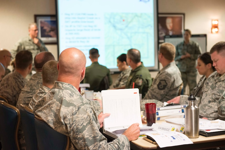 The 366th and 124th Fighter Wings walk through emergency checklists in a response exercise at Mountain Home Air Force Base, Nov. 30, 2016. The two wings collaborated on updating and improving checklists, while training for a mass accident response. (U.S. Air Force photo by 2nd Lt. Kevyn Stinett/Released)