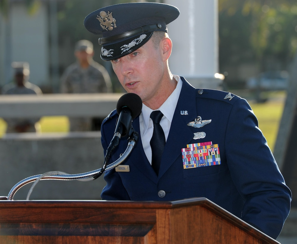 Col. Kevin Gordon, 15th Wing commander, delivers a speech during the 75th Commemoration of the December 7, 1941 attack on Hickam Field ceremony  Dec. 7, 2016, at Joint Base Pearl Harbor-Hickam, Hawaii. The attacks on seven bases throughout Oahu precipitated America's entry into World War II, and the annual commemoration ceremony is designed to foster reflection, remembrance, and understanding for those affected by the events that took place 75 years ago. (U.S. Air Force photo by Tech. Sgt. Nathan Allen)