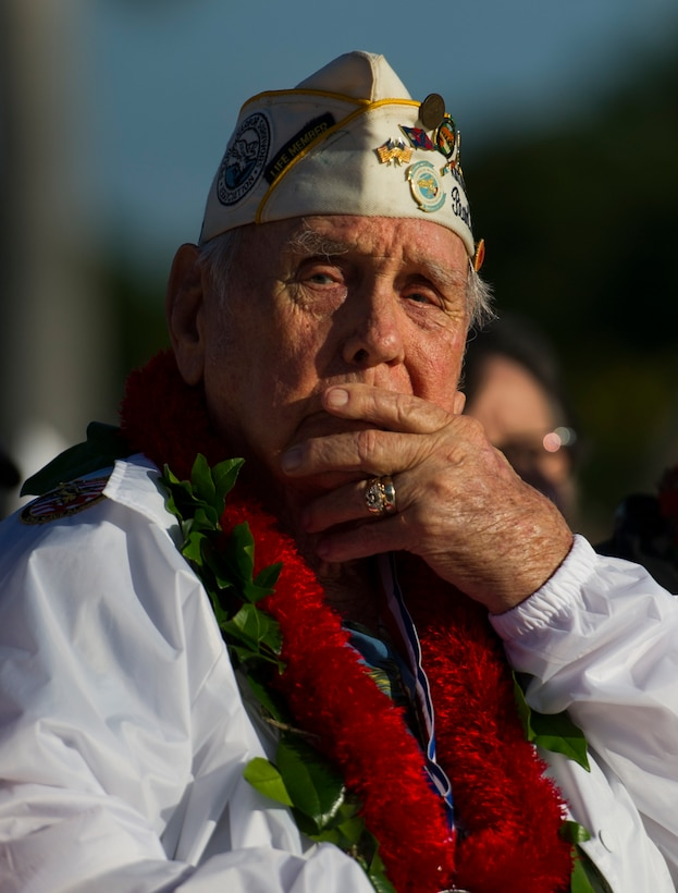 Former U.S. Air Force Staff Sgt. Durward Swanson reflects during the 75th Commemoration of the Dec. 7, 1941 attack on Hickam Field ceremony Dec. 7, 2016, at Joint Base Pearl Harbor-Hickam, Hawaii. Swanson was assigned to Hickam Field as a security forces guard. After the attack, he served as a B-17 Flying Fortress crew chief. During the Battle of Midway, his aircraft was hit and crash-landed in the water. Seven of the 10-man crew were killed. Swanson received severe injuries and spent nine months in the hospital. He received the Distinguished Flying Cross, a Purple Heart, and an honorable discharge. (U.S. Air Force photo by Tech. Sgt. Nathan Allen)