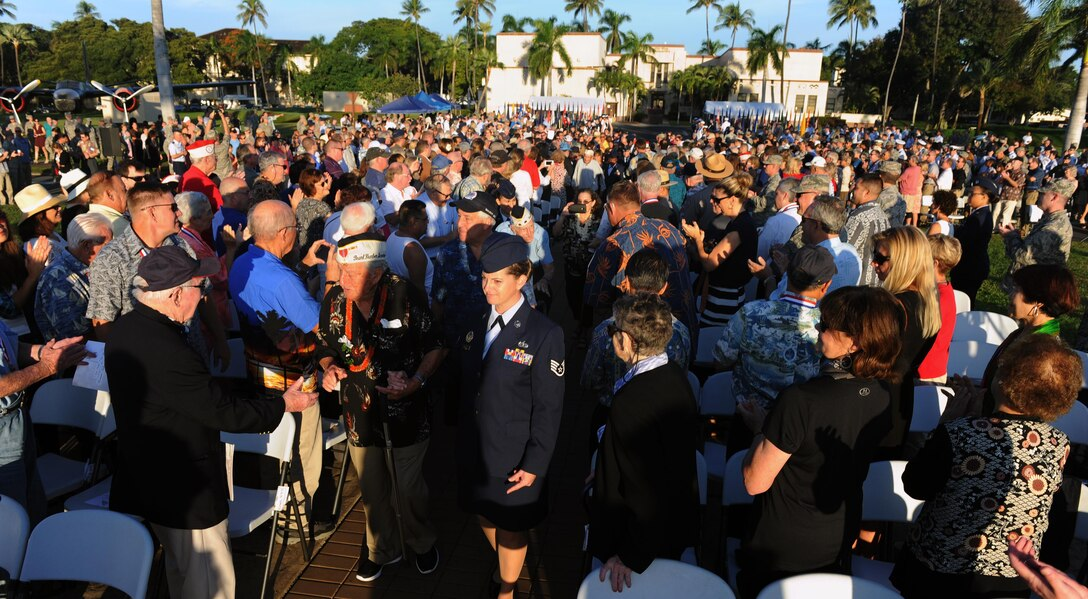 Survivors of the attacks on Pearl Harbor Naval Station and Hickam Field are honored as they enter the 75th Commemoration of the Dec. 7, 1941 Attack on Hickam Field ceremony Dec. 7, 2016, at Joint Base Pearl Harbor-Hickam, Hawaii. The attacks on seven bases throughout Oahu precipitated America's entry into World War II, and the annual commemoration ceremony is designed to foster reflection, remembrance, and understanding for those affected by the events that took place 75 years ago. (U.S. Air Force photo by Tech. Sgt. Nathan Allen)