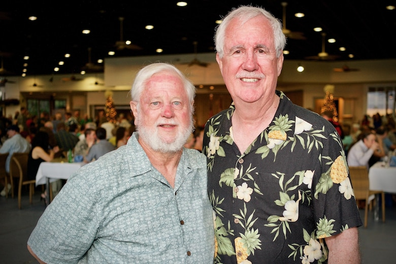 Mr. Stan Loer (left) and U.S. Army retired colonel Davide Burpee (right) pose together after meeting for the first time at a Dec. 7 rememberance dinner, Dec. 6, 2016, Joint Base Pearl Harbor-Hickam, Hawaii. Loer and Burpee were both born at Tripler Army Medical Center on the island of Oahu on Dec. 7, 1941. They participcated in a dinner that was part of a week long celebration commemorating the 75th anniversary of the attacks on Pearl Harbor, Hickam Field and Oahu. The U.S. military and the State of Hawaii are hosting a series of remembrance events to honor the Pacific Theater's veterans. (U.S. Air Force photo by Tech. Sgt. James Stewart/Released)