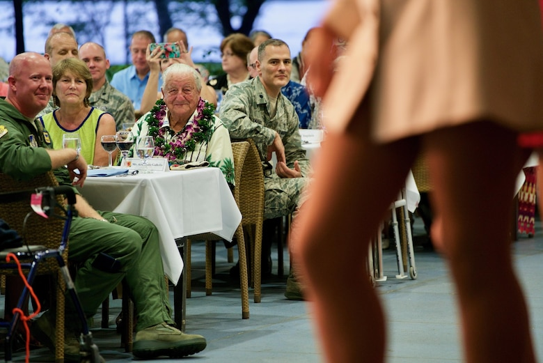 Mr. Armando Gallela, a Dec. 7 attacks survivor, watches the USO Show Troupe perform during a rememberance dinner, Dec. 6. 2016, Joint Base Pearl Harbor-Hickam, Hawaii. The dinner was part of a week long celebration commemorating the 75th anniversary of the attacks on Pearl Harbor, Hickam Field and Oahu. The U.S. military and the State of Hawaii are hosting a series of remembrance events to honor the Pacific Theater's veterans. (U.S. Air Force photo by Tech. Sgt. James Stewart/Released)