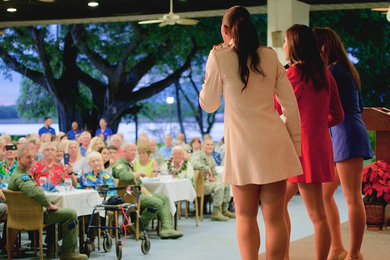 The USO Show Troupe performs for dinner guests during a Dec. 7 rememberance dinner, Dec. 6, 2016, Joint Base Pearl Harbor-Hickam, Hawaii. The dinner was part of a week long celebration commemorating the 75th anniversary of the attacks on Pearl Harbor, Hickam Field and Oahu. The U.S. military and the State of Hawaii are hosting a series of remembrance events to honor the Pacific Theater's veterans. (U.S. Air Force photo by Tech. Sgt. James Stewart/Released)