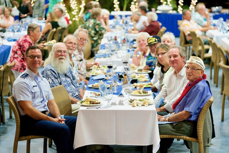 U.S. Air Force Maj. Gen. Mark Dillon, Pacific Air Forces vice commander, and Clifford McFarland, Dec. 7 attacks survivor, enjoy their meals during a rememberance dinner, Dec. 6, 2016, Joint Base Pearl Harbor-Hickam, Hawaii. The dinner was part of a week long celebration commemorating the 75th anniversary of the attacks on Pearl Harbor, Hickam Field and Oahu. The U.S. military and the State of Hawaii are hosting a series of remembrance events to honor the Pacific Theater's veterans. (U.S. Air Force photo by Tech. Sgt. James Stewart/Released)