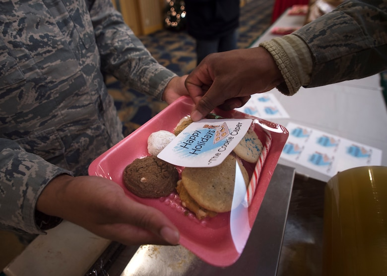 U.S. Air Force Airmen package cookies for delivery during the annual Cookie Caper event at Misawa Air Base, Japan, Dec. 7, 2016. After the cookies are divided and packaged, first sergeants and other leadership across the base hand delivered them to their units.  (U.S. Air Force photo by Senior Airman Deana Heitzman)
