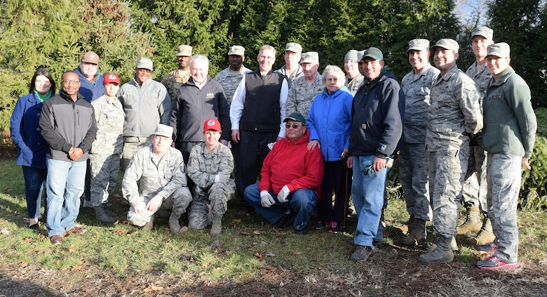 After hoisting nearly 100 Christmas trees bound for global distribution, area Pa. National Guard service members teamed with family members of the Bustard Tree Farm, state and local representatives take the time to pose for a group photo at the farm located in Lansdale, Pa., Dec. 2, 2016. Among the keynote speakers during the Trees for Troops program kickoff there, were State Rep. John Rafferty, Jr., 44th Pa. District (center left, black jacket) and Pa. Secretary of Agriculture, Russell Redding (black vest).  (U.S. Air National Guard photo by Master Sgt. Christopher Botzum)