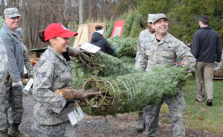 Senior Airman Ramona Navarro (left) and Senior Airman Waldo Masias, heavy equipment mechanics here at the 111th Attack Wing, trade in their wrenches and ratchets for tree-worthy work gloves in support of the Trees for Troops donation program held at the Bustard's Tree Farm in Lansdale, Pa. Dec. 2, 2016. Over a dozen Pa. National Guard service members from the Horsham Air Guard Station and surrounding communities provided the muscle loading Christmas trees destine for an estimated 65 military bases across the globe. (U.S. Air National Guard photo by Master Sgt. Christopher Botzum)
