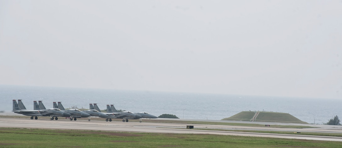 U.S. Air Force F-15 Eagles from the 67th Fighter Squadron wait to take off Dec. 6, 2016, at Kadena Air Base, Japan. The F-15 Eagle's air superiority is achieved through a mixture of exceptional maneuverability and acceleration, range, weapons and avionics. (U.S. Air Force photo by Senior Airman Lynette M. Rolen/Released)