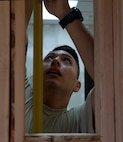 U.S. Air Force Airman 1st Class Jacob Vigil, 18th Civil Engineer Squadron structural apprentice, measures a wall frame for drywall Dec. 7, 2016, at Kadena Air Base, Japan. Checking for proper measurements for drywall ensures a strong interior wall. (U.S. Air Force photo by Senior Airman Lynette M. Rolen/Released)