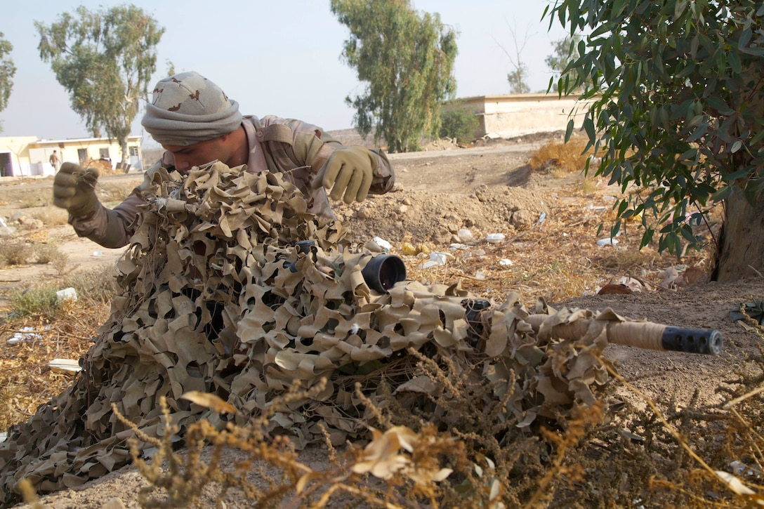 Iraqi soldiers, acting as a fire team, utilize their environment to camouflage themselves while undergoing stalking training for snipers during Combined Joint Task Force-Operation Inherent Resolve (CJTF-OIR) at Camp Taji, Iraq, Nov. 16, 2016. CJTF-OIR is a multinational effort to weaken and destroy Islamic State in Iraq and the Levant operations in the Middle East region and around the world. (U.S. Army photo by Spc. Craig Jensen)