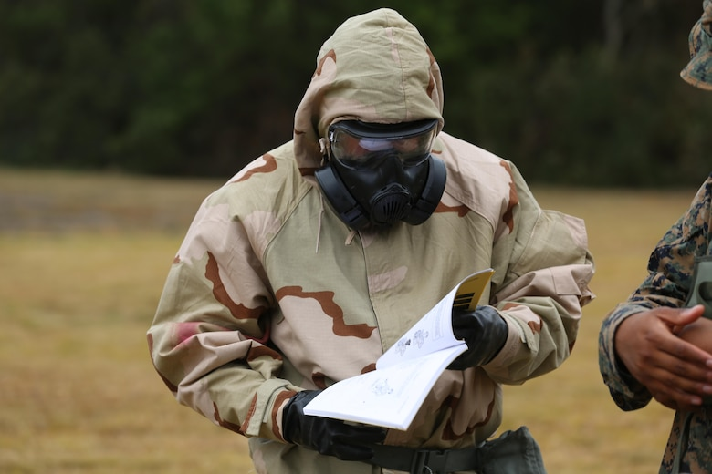 A Marine reads training material during a field exercise at Marine Corps Outlying Field Atlantic Nov. 30, 2016. Twenty-two Marines with Chemical, Biological, Radiological and Nuclear Defense, 2nd Marine Aircraft Wing, conducted a week-long annual training exercise that refreshed the defense specialists on the roots of their basic military occupational specialty training. The exercise included an assortment of stations and classes that tested the Marines physically and mentally. (U.S. Marine Corps photo by Lance Cpl. Cody Lemons/Released)