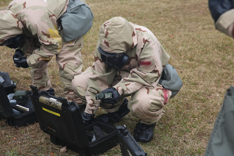 A Marine removes his joint chemical agent detector during a field exercise at Marine Corps Outlying Field Atlantic Nov. 30, 2016. Twenty-two Marines with Chemical, Biological, Radiological and Nuclear Defense, 2nd Marine Aircraft Wing, conducted a week-long annual training exercise that refreshed the defense specialists on the roots of their basic military occupational specialty training. The exercise included an assortment of stations and classes that tested the Marines physically and mentally. (U.S. Marine Corps photo by Lance Cpl. Cody Lemons/Released)