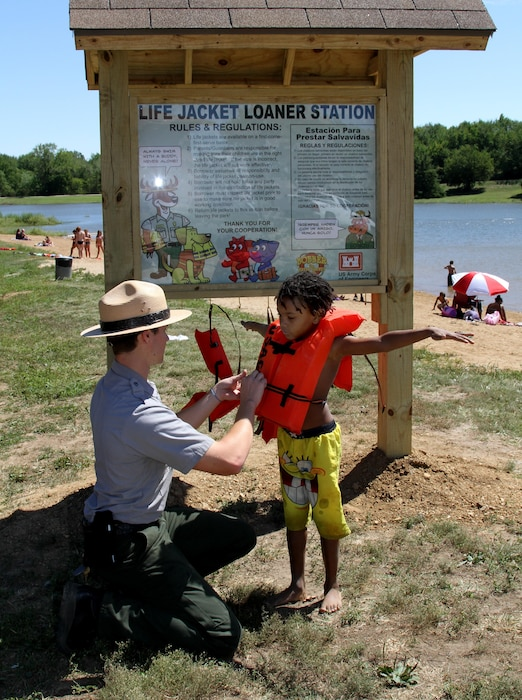 Park rangers promote water safety and assist with finding loaner life jackets and correct fitting.