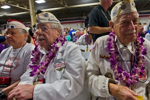 Pearl Harbor survivor and Navy veteran Delton Walling, right, Sons and Daughters of Pearl Harbor Survivors member Joanne Ericksen, left, and her father, Pearl Harbor survivor and Navy veteran Mel Heckman, attend the commemoration for the 75th anniversary of the Pearl Harbor attack, at Joint Base Pearl Harbor-Hickam, Hawaii, Dec. 7, 2016. DoD photo by Lisa Ferdinando