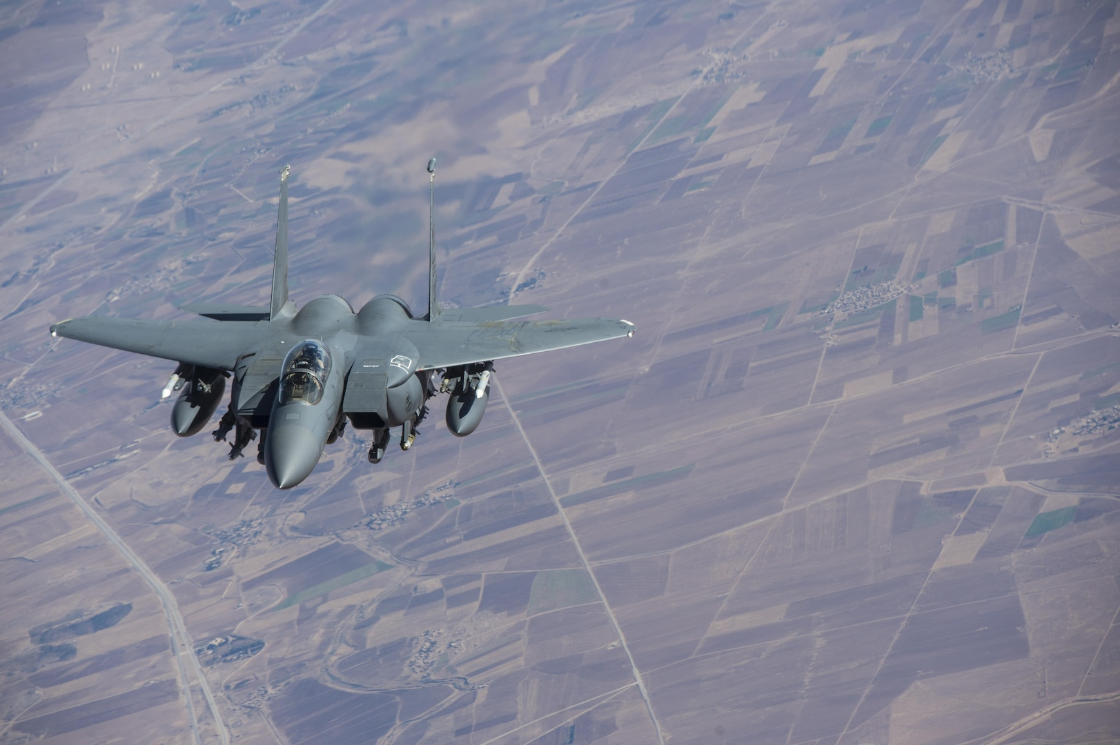 A U.S. Air Force F-15 Strike Eagle approaches a KC-135 Stratotanker in support of a Combined Joint Task Force - Operation Inherent Resolve mission over Iraq Dec. 7, 2016. The KC-135 provides aerial refueling capabilities for the CJTF as it supports the Iraqi Security Forces and the partnered forces in Syria as they work to liberate territory and people under the control of Da'esh. (U.S. Air Force photo by Staff Sgt. Matthew B. Fredericks)