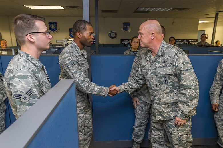 Gen. John Raymond, commander of Air Force Space Command, meets several cyber operators from the 690th Network Support Squadron Dec. 5, 2016 at Joint Base San Antonio-Lackland. (U.S. Air Force photo/Lt. Col. Cade Sonnichsen)