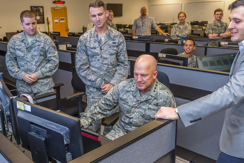 Gen. John Raymond, commander of Air Force Space Command, explores some of the technology 24th Air force cyber specialists from the 92nd Cyberspace Operations Squadron work with on a daily basis at Joint Base San Antonio-Lackland Dec. 5, 2016. (U.S. Air Force photo/Lt. Col. Cade Sonnichsen)