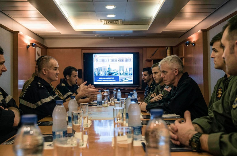 161206-N-XD363-021 MEDITERRANEAN SEA (Dec. 6, 2016) Rear Adm. James Malloy, commander, Carrier Strike Group (CSG) 10, meets with French Rear Adm. Olivier Lebas, left, commander, Task Force 473, on the aircraft carrier FS Charles de Gaulle (R91). CSG 10 is deployed as part of the Eisenhower Carrier Strike Group to conduct naval operations in the U.S. 6th Fleet area of operations in support of U.S. national security interests in Europe. (U.S. Navy photo by Petty Officer 2nd Class Michael R. Gendron/Released)