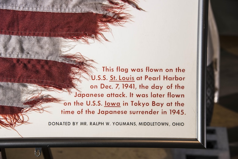 DAYTON, Ohio - This flag was flown on the U.S.S. St. Louis at Pearl Harbor on Dec. 7, 1941, the day of the Japanese attack. It was later flown on the U.S.S. Iowa in Tokyo Bay at the time of the Japanese surrender in 1945. The flag was donated by Mr. Ralph W. Youmans from Middletown, Ohio. The U.S. flag on display has been temporarily removed for conservation treatment. (U.S. Air Force photo by Ken LaRock)