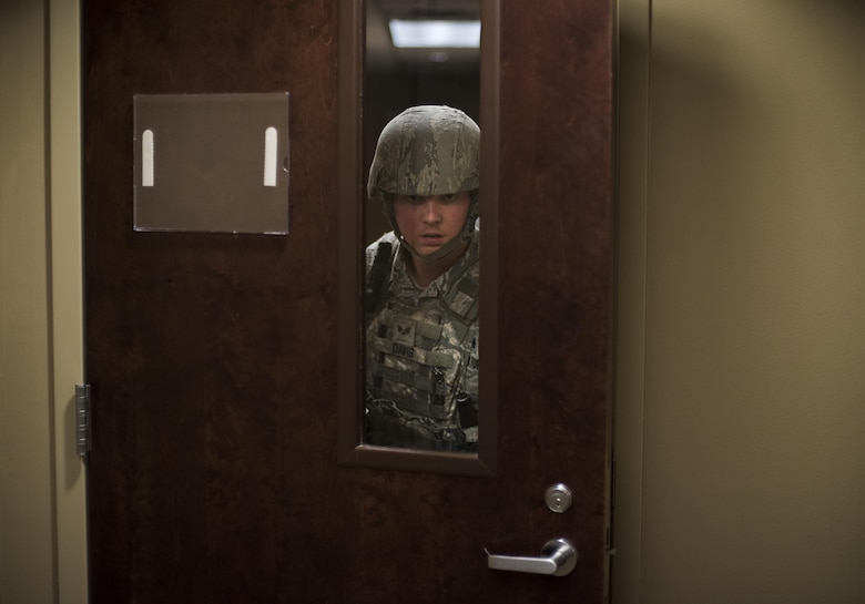 Senior Airman Alexander Davis, 2nd Security Forces Squadron patrolman, searches rooms for victims and potential threats during an active shooter exercise at Barksdale Air Force Base, La., Nov. 29, 2016.  Exercises allow the commander to see exactly what areas need more focus and training, and a means to enhance readiness, boost capabilities and streamline procedures in the event of a major incident. (U.S. Air Force photo/Senior Airman Damon Kasberg)