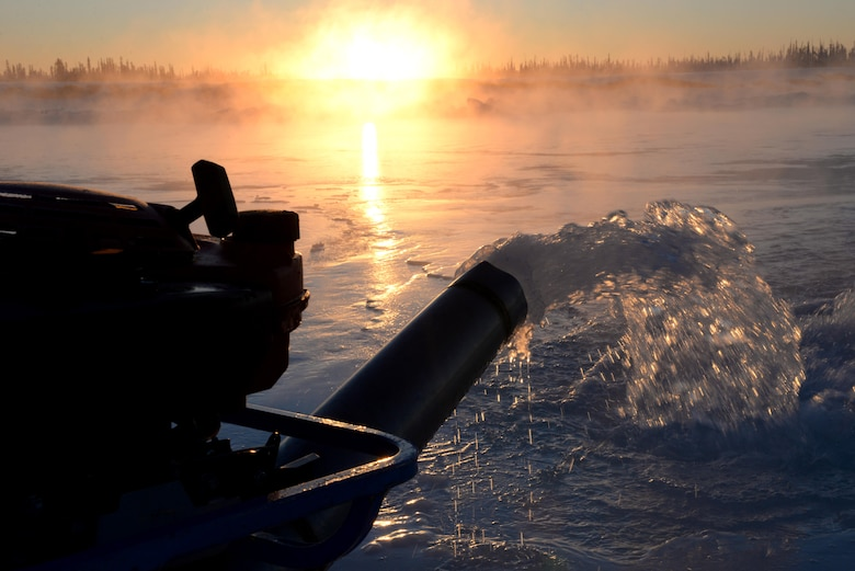 A water pump belonging to the 354th Civil Engineer Squadron was placed through ice on the Tanana River Dec. 5, 2016, in Fairbanks, Alaska. The pump is put into a hole in the ice to force water to the surface and create a smooth path for vehicles. (U.S. Air Force photo by Airman 1st Class Cassandra Whitman)