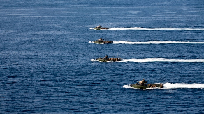 U.S. 5TH FLEET AREA OF OPERATIONS (Dec. 6, 2016) Amphibious assault vehicles with the 11th Marine Expeditionary Unit move in formation through the Gulf of Aden during an amphibious assault rehearsal as part of Exercise Alligator Dagger, Dec. 6, 2016. The Makin Island Amphibious Ready Group (ARG) and 11th Marine Expeditionary Unit (MEU) will conduct amphibious operations and combat sustainment training. The ARG/MEU Navy-Marine Corps team is operating in the U.S. 5th Fleet area of responsibility in support of maritime security operations, crisis response, and theater security cooperation efforts to ensure the free flow of commerce, freedom of navigation and regional security. (U.S. Marine Corps photo by Cpl. Devan K. Gowans)
