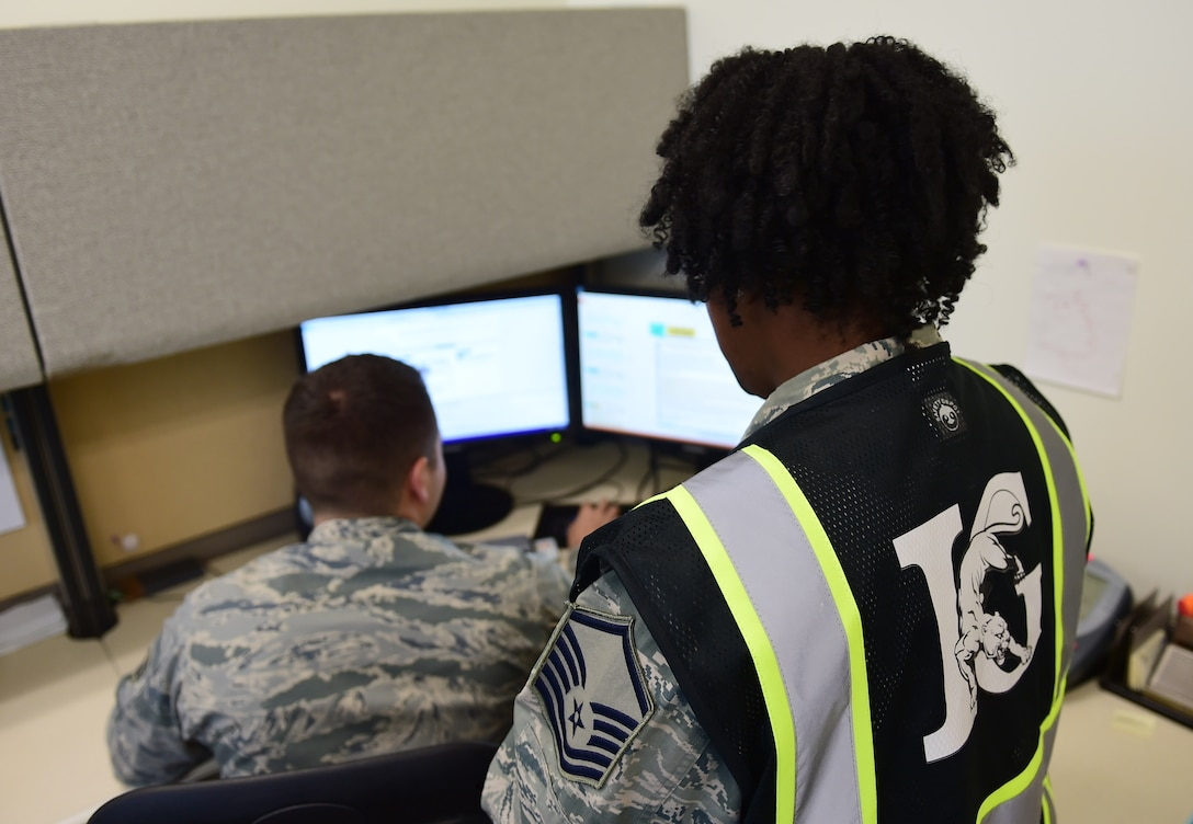 Master Sgt. Lacey Ranson, 460th Space Wing Inspector General superintendent, simulates a computer-based inspection with Staff Sgt. Mitchell Montepagano, 460th SW IG Self-Assessment Program/Management Internal Control Tool manager Nov. 29, 2016, on Buckley Air Force Base, Colo. Inspections ensure installation readiness and provide feedback to the commander on proficiency and deficiencies throughout the base. (U.S. Air Force photo by Airman Jacob Deatherage/Released)