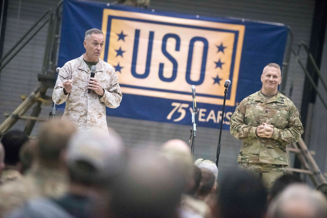 Marine Corps Gen. Joe Dunford, chairman of the Joint Chiefs of Staff, and Army Command Sgt. Maj. John W. Troxell, the chairman's senior enlisted advisor, talk to service members.