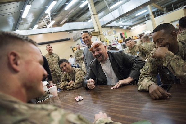 Mentalist Jim Karol performs mind games with service members during a troop engagement at Forward Operation Base Gamberi, Afghanistan, Dec. 7, 2016. Marine Gen. Joseph F. Dunford, Jr., chairman of the Joint Chiefs of Staff, along with USO entertainers, visited service members who are deployed from home during the holidays at various locations across the globe.  This year's entertainers included actors Chris Evans, actress Scarlett Johansson, NBA Legend Ray Allen, 4-time Olympic Medalist Maya DiRado, Country Music Singer Craig Campbell, and mentalist Jim Karol. (DoD photo by Navy Petty Officer 2nd Class Dominique A. Pineiro)