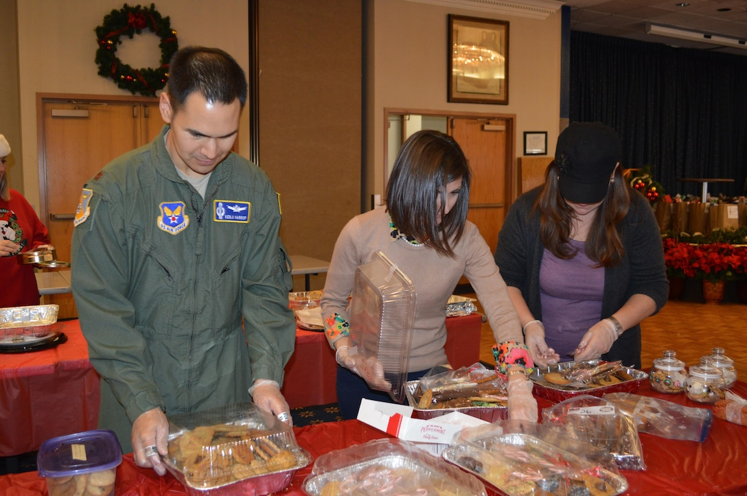Volunteers package cookies during last year's Team Kirtland Airman Cookie Drive. Each year in December, Kirtland Spouses' Club members collect cookies for single Airmen living in the base dorms. They hope to collect 10,000 cookies this year.