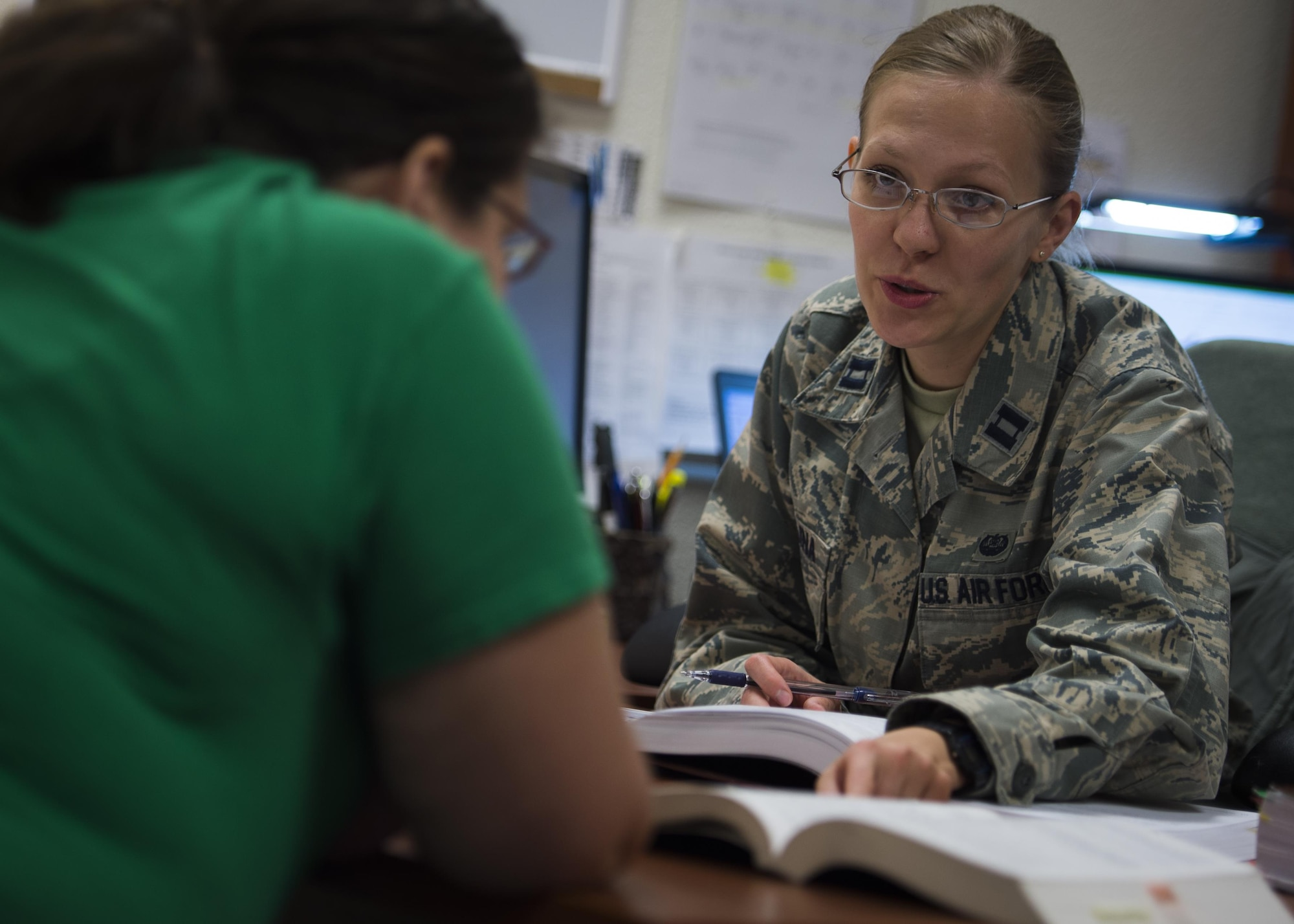 Captain Ekaterina Korulina, the appointed Special Victims Counsel attorney practices her procedures in a controlled environment with stand-in Josephine Brechtold, the Airman and Family Readiness Center family services lead coordinator at Holloman Air Force Base, N.M. The Special Victims Counsel offers confidential legal advice and assistance to sexual assault victims. (U.S. Air Force photo by Senior Airman Aaron Montoya)