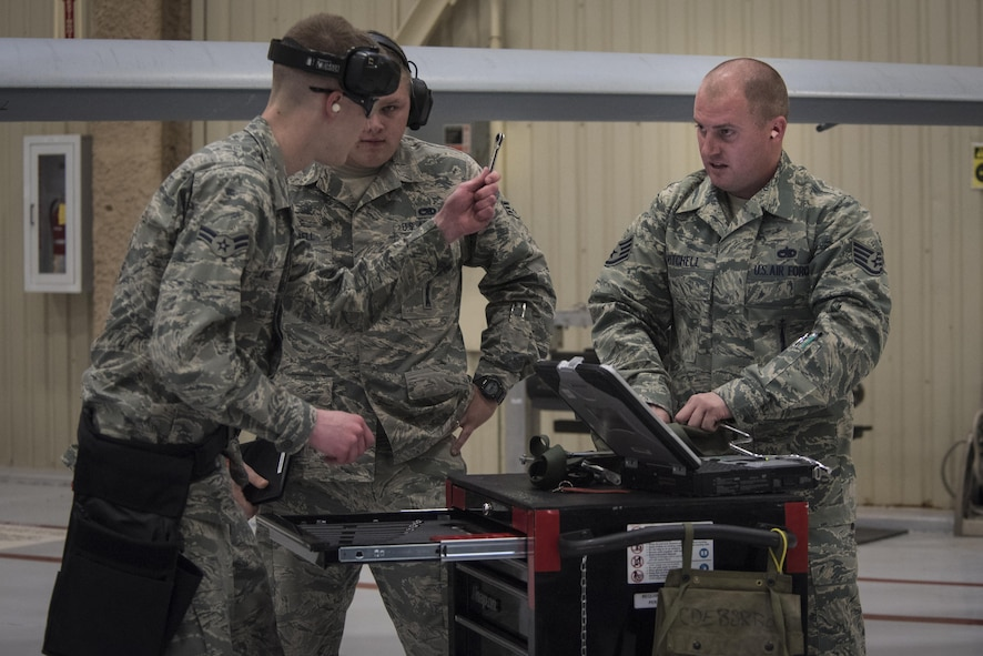 Air Commandos with the 27th Special Operations Maintenance Squadron rush to complete their tasking for a weapons load competition Dec. 2, 2016, at Cannon Air Force Base, N.M. The competition tests weapons load crews' proficiency, reliability and speed. (U.S. Air Force Photo by Senior Airman Shelby Kay-Fantozzi/released)