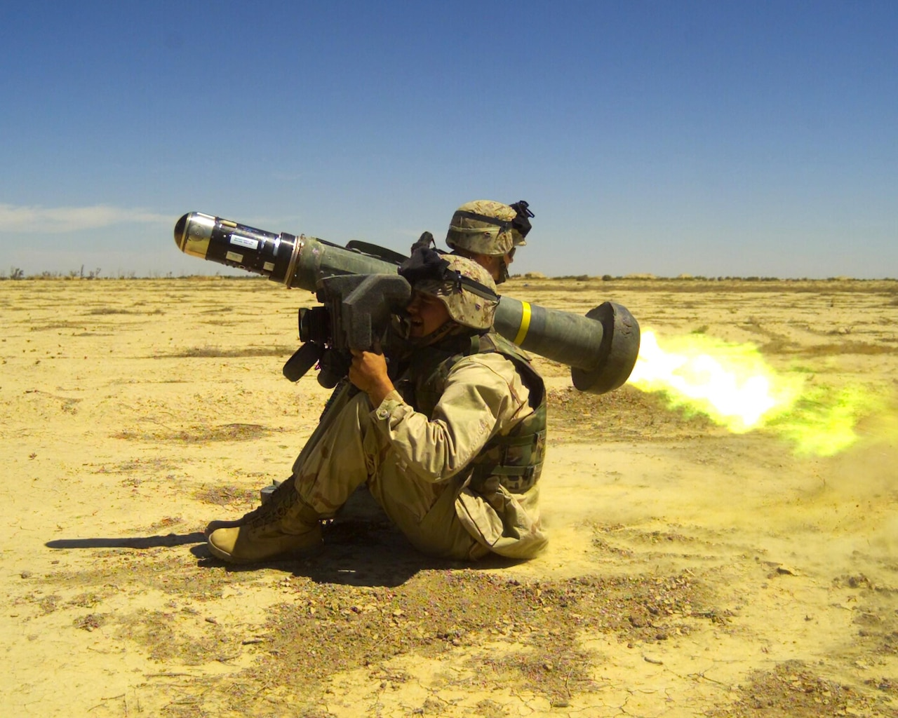 Beginning in the 1970s, the Defense Advanced Research Projects Agency began the Tank Breaker program in response to deficiencies identified by the Army and Marine Corps in their existing infantry anti-tank weapon. The Army later renamed the weapon Javelin, which entered full-scale production in 1997. It was the world's first medium-range, one-man-portable, fire-and-forget anti-tank weapon system. Here, a soldier fires an FGM-148 Javelin anti-tank weapon, May 2, 2003. Marine Corps photo by Sgt. Mauricio Campino