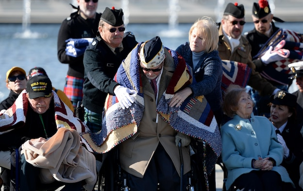 Retired Air Force Chief Warrant Officer Jay C. Groff Jr. is covered with a Quilt of Valor that was given to all the World War II veterans during the 2016 Pearl Harbor Remembrance Day 75th Anniversary Commemoration at the World War II Memorial in Washington, D.C., Dec. 7, 2016. Stationed at Hickam Field in Oahu, Hawaii, Groff heard an explosion on Dec. 7, 1941, and raced out of the barracks to defend against the attack. (U.S. Army photo/Sgt. Jose A. Torres Jr.)