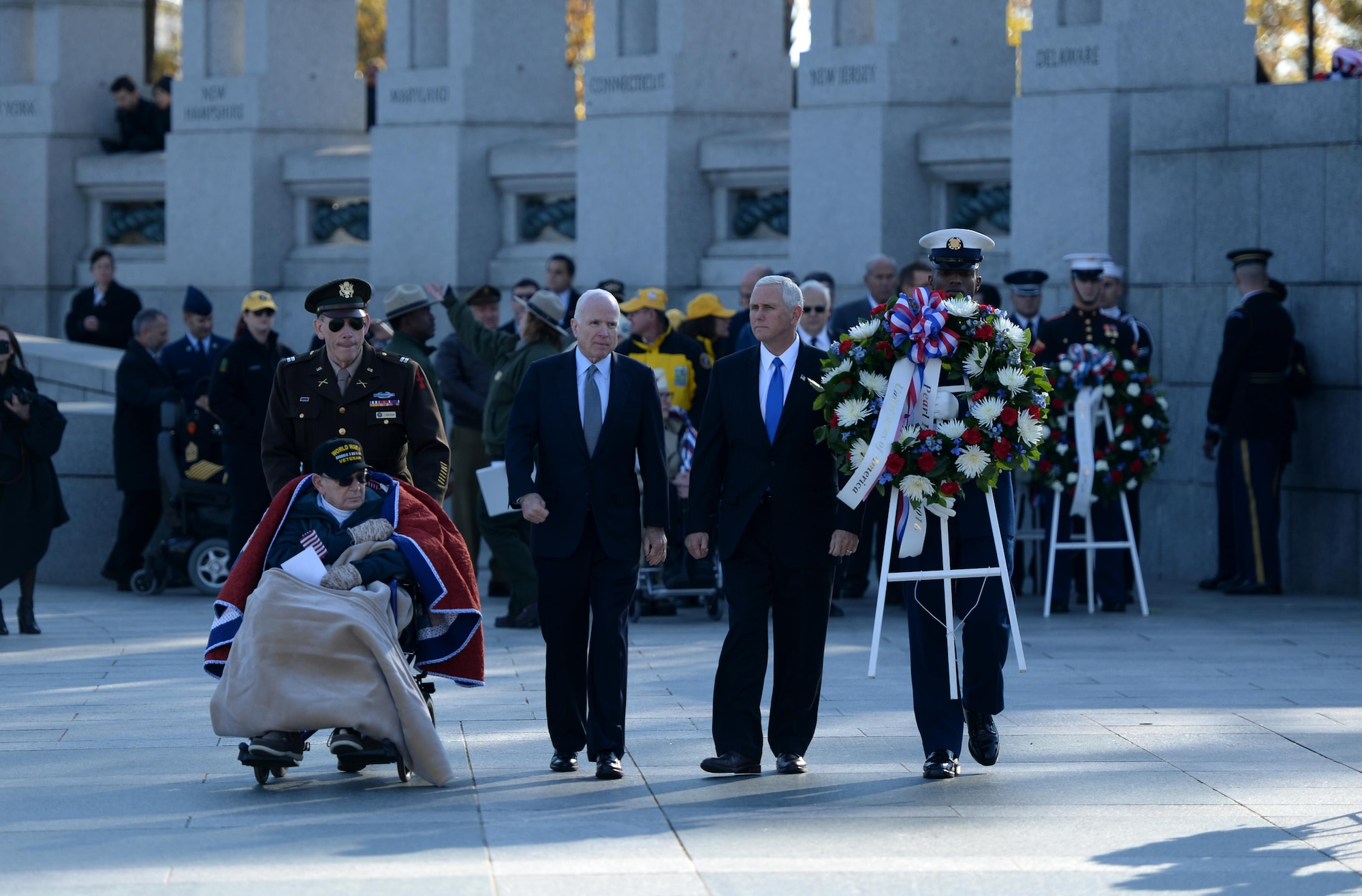 World War II veteran William Flatters, U.S. Sen. John McCain and Vice President-elect Mike Pence walk toward the location they will be laying a wreath during the 2016 Pearl Harbor Remembrance Day 75th Anniversary Commemoration at the World War II Memorial in Washington, D.C., Dec. 7, 2016. (U.S. Army photo/Sgt. Jose A. Torres Jr.)