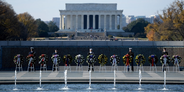 Honor guards from each branch of the military guard the wreaths during the 2016 Pearl Harbor Remembrance Day 75th Anniversary Commemoration at the World War II Memorial in Washington, D.C., Dec. 7, 2016. (U.S. Army photo/Sgt. Jose A. Torres Jr.)