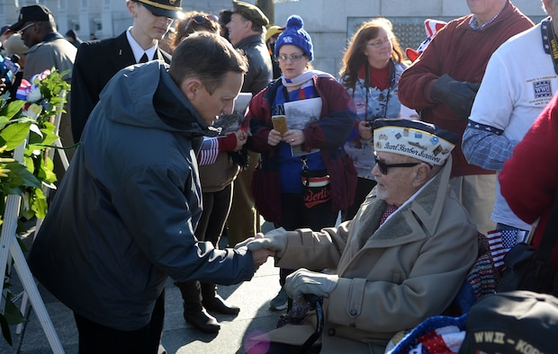 World War II veteran and retired Air Force Chief Warrant Officer Jay C. Groff Jr. is greeted and surrounded by attendees of the 2016 Pearl Harbor Remembrance Day 75th Anniversary Commemoration at the World War II Memorial in Washington, D.C., Dec. 7, 2016. (U.S. Army photo/Sgt. Jose A. Torres Jr.)