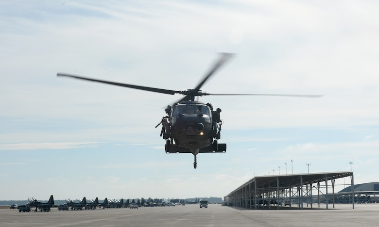 A U.S. Air Force 66th Rescue Squadron HH-60G Pave Hawk takes off during Checkered Flag 17-1 exercise at Tyndall Air Force Base, Fla., Dec. 8, 2016. The goal of the 66th RQS is to be the most capable and reliable personnel recovery force in the world for all peacetime and combat operations. The 66th RQS is from Nellis Air Force Base, Nevada. (U.S. Air Force photo by Airman 1st Class Cody R. Miller/Released)