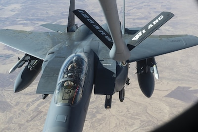 A U.S. Air Force F-15E Strike Eagle approaches a KC-135 Stratotanker in support of a Combined Joint Task Force Operation Inherent Resolve mission over Iraq, Dec. 7, 2016. The KC-135 provides aerial refueling capabilities as the task force supports the Iraqi security forces and the partnered forces in Syria as they work to liberate territory and people under the control of the Islamic State of Iraq and the Levant. Air Force photo by Staff Sgt. Matthew B. Fredericks