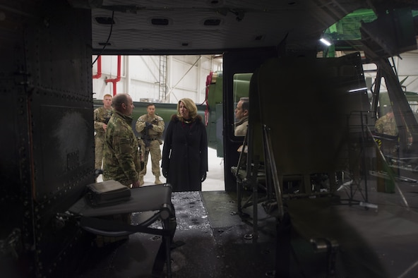 "Secretary of the Air Force Deborah Lee James receives a briefing about the UH-1N ""Huey"" and its contribution to the ICBM mission at F.E. Warren Air Force Base, Wyo., Dec. 8, 2016. The 37th Helicopter Squadron plays an important role protecting America's nuclear assets while on missile convoys and patrols in the missile complex. (U.S. Air Force photo by Staff Sgt. Christopher Ruano)"