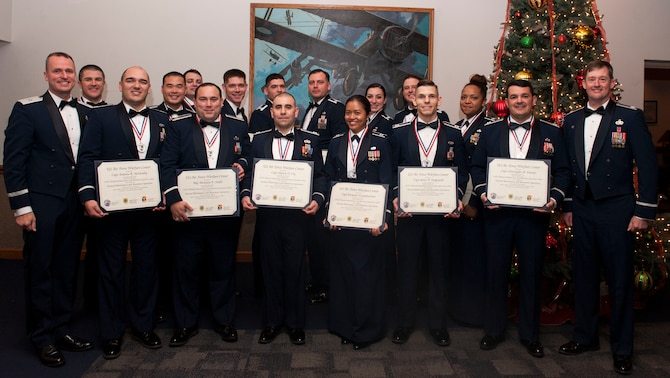 Graduates of the U.S. Air Force Advanced Maintenance and Munitions Operations School's first Advanced Sortie Production Course pose for a photo during their graduation ceremony at Nellis Air Force Base, Nev., Dec. 7, 2016. The 12-week ASPC course -- which targets maintenance, munitions and logistics readiness officers in their four to nine year time-in-service window -- teaches its students to think and view problems differently, ultimately to help them solve sortie production deficiencies more effectively.